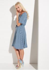 Granatowa sukienka w kropki z wiązaniem w pasie