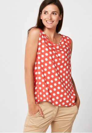 Airy orange blouse with dots