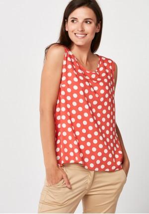 Zwiewna pomarańczowa bluzka w kropki