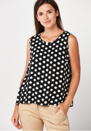 Airy black blouse with dots