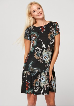 Dress with green patterns and frill