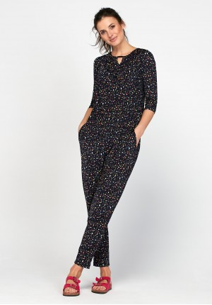 Navy blue jumpsuit with colorful figures