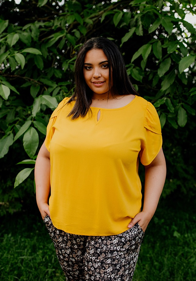 Yellow blouse with a cut-out